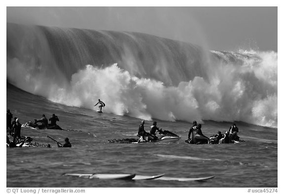 Waverunners and surfer in big wave. Half Moon Bay, California, USA (black and white)