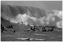 Waverunners and surfer in big wave. Half Moon Bay, California, USA ( black and white)