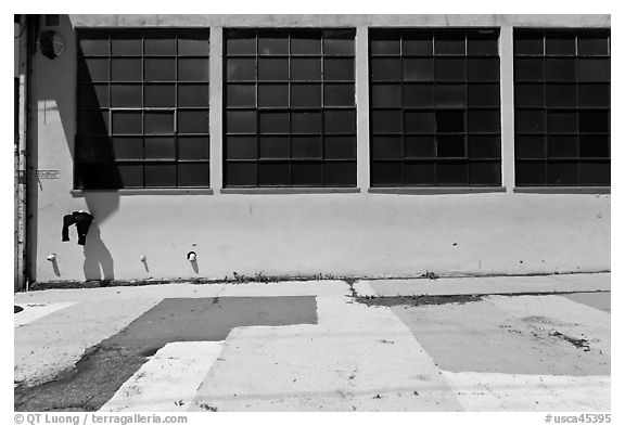 Industrial building and painted sidewalk. Berkeley, California, USA (black and white)