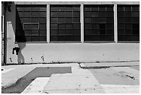 Industrial building and painted sidewalk. Berkeley, California, USA ( black and white)