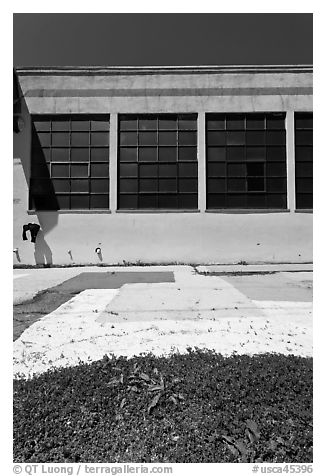 Sidewalk and industrial building facade. Berkeley, California, USA (black and white)