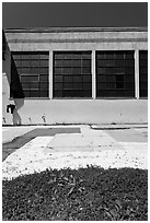 Sidewalk and industrial building facade. Berkeley, California, USA ( black and white)
