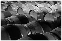 Rows of wine barrels in cellar, close-up. Napa Valley, California, USA (black and white)