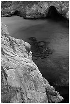 Green waters of China Cove. Point Lobos State Preserve, California, USA ( black and white)