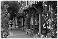Sidewalk and stores on Ocean Avenue. Carmel-by-the-Sea, California, USA (black and white)