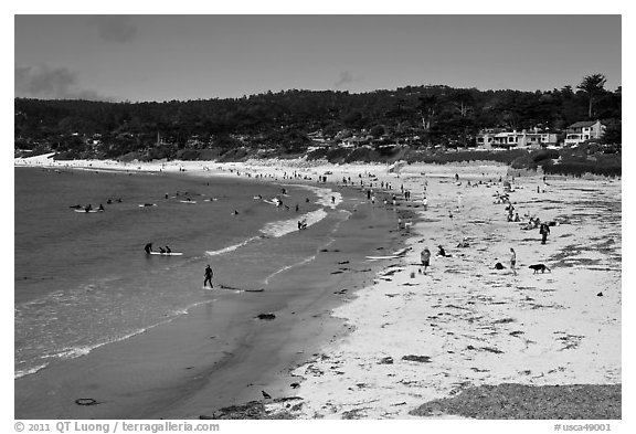 Beachgoers on Carmel Beach. Carmel-by-the-Sea, California, USA (black and white)