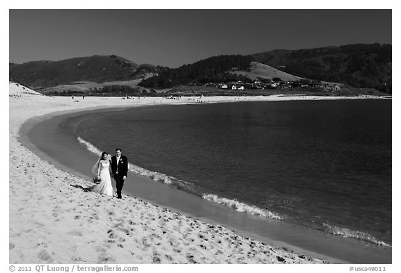 Groom and bride, Carmel River Beach. Carmel-by-the-Sea, California, USA