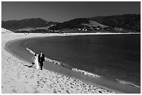 Groom and bride, Carmel River Beach. Carmel-by-the-Sea, California, USA (black and white)