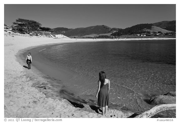 Women stroll on Carmel River Beach. Carmel-by-the-Sea, California, USA (black and white)