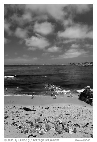 People sunning themselves on beach. Pacific Grove, California, USA (black and white)