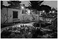 Garden and historic adobe house at night. Monterey, California, USA ( black and white)
