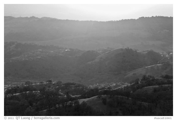 Hills below Mount Hamilton at sunset. San Jose, California, USA (black and white)