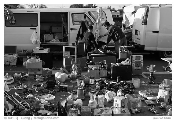 Vans and household items for sale, San Jose Flee Market. San Jose, California, USA (black and white)