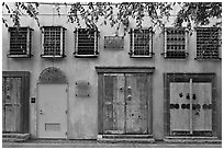 Wall with weathered doors and windows. Santana Row, San Jose, California, USA ( black and white)