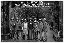 Rangers posing with Theodore Roosevelt under entrance gate. Muir Woods National Monument, California, USA (black and white)
