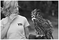 Owl perched on woman's arm, Alum Rock Park. San Jose, California, USA (black and white)