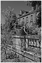 Balustrade, blossoms, and house, Filoli estate. Woodside,  California, USA (black and white)