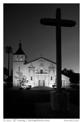 Cross and Santa Clara Mission at dusk. Santa Clara, California, USA