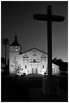 Cross and Santa Clara Mission at dusk. Santa Clara,  California, USA (black and white)