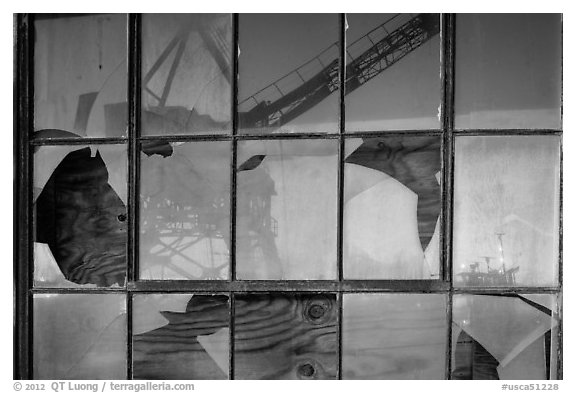 Crane reflected in broken windows, Rosie the Riveter Home Front National Historical Park. Richmond, California, USA (black and white)