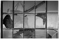Crane reflected in broken windows, Rosie the Riveter Home Front National Historical Park. Richmond, California, USA ( black and white)