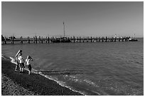 Girls on China Camp Beach near pier, China Camp State Park. San Pablo Bay, California, USA (black and white)