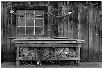 Shed with fishing gear and Chinese dragon, China Camp State Park. San Pablo Bay, California, USA (black and white)