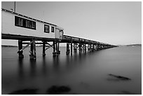 Long pier at sunset, San Pablo Bay. San Pablo Bay, California, USA (black and white)
