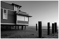 Pilings and beach house at sunset, Stinson Beach. California, USA (black and white)