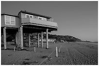 Beach house with high stilts, Stinson Beach. California, USA (black and white)