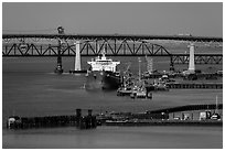 Pier, oil tanker, and Benicia-Martinez bridge. Martinez, California, USA (black and white)