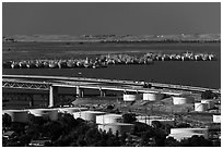 Oil tanks, Carquinez Strait, and mothball fleet. Martinez, California, USA (black and white)
