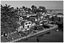 Houses bordering Soquel Creek from above. Capitola, California, USA ( black and white)