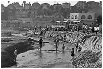 Children playing in tidal stream. Capitola, California, USA ( black and white)