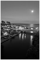 Moon rising over Soquel Creek and Ocean. Capitola, California, USA (black and white)