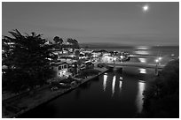 Capitola village, Soquel Creek and moon. Capitola, California, USA (black and white)