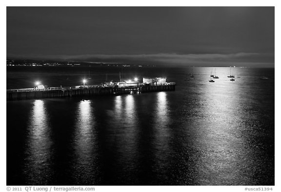 Pier and yachts with moon reflection. Capitola, California, USA (black and white)
