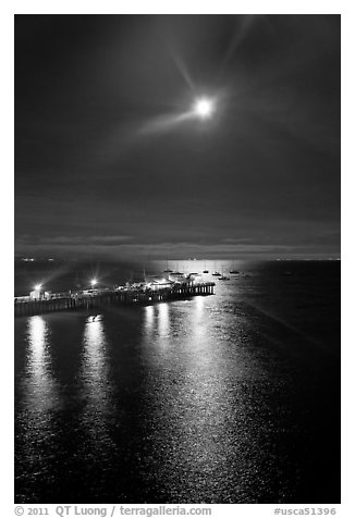 Moon and fishing pier by night. Capitola, California, USA
