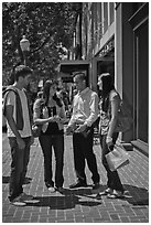 Group talking on University Avenue. Palo Alto,  California, USA (black and white)