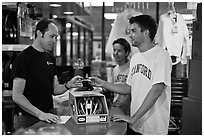 Students paying at register with credit card, Campus Bike Shop. Stanford University, California, USA ( black and white)
