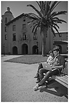 Students with laptop on bench. Stanford University, California, USA (black and white)