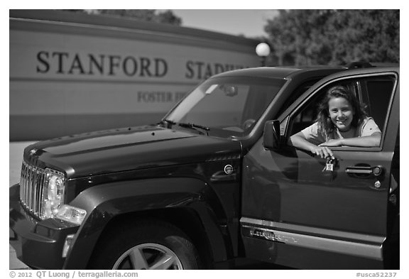 Student with new car. Stanford University, California, USA (black and white)