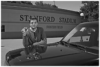 Student showing car keys. Stanford University, California, USA (black and white)