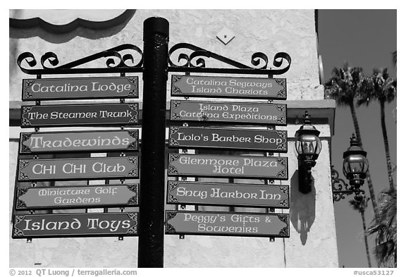 Signs pointing to local businesses, Avalon Bay, Catalina. California, USA (black and white)
