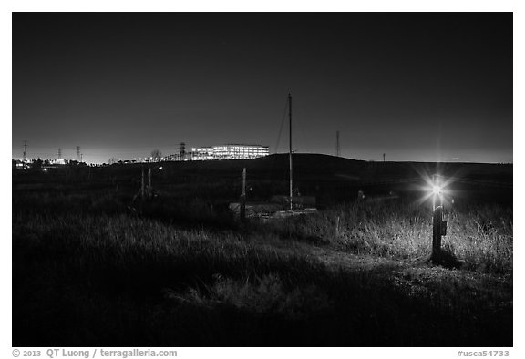Marsh by night with office building in distance, Alviso. San Jose, California, USA (black and white)