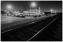 Railroad tracks and restaurant at night, Alviso. San Jose, California, USA (black and white)