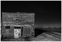 Shack, rails, and bay by night, Alviso. San Jose, California, USA (black and white)
