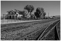 Kelso Depot across railroad tracks. Mojave National Preserve, California, USA (black and white)
