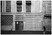 Woman standing in front of false facade, New York backlot, Paramount studios. Hollywood, Los Angeles, California, USA (black and white)