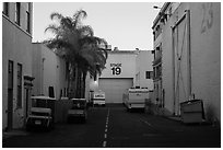 Carts, production trails, and stages at dusk, Paramount lot. Hollywood, Los Angeles, California, USA (black and white)
